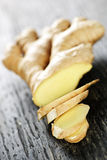 Ginger root. Close up of sliced fresh ginger root spice on wooden table Stock Images