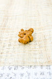 Ginger root on Asian writing Royalty Free Stock Image