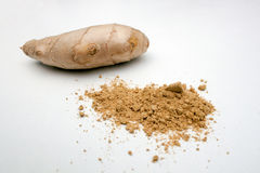 Ginger root and gingers powder. Ginger root and ginger powder on a white background Royalty Free Stock Photo