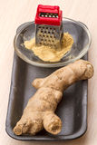 Ginger root and grater Stock Photo
