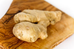 Ginger root, isolated on the wooden background Stock Image