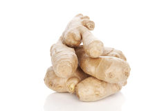 Ginger root over white. Stock Photos