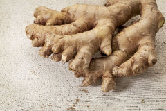 Ginger root. On a rustic white painted barn wood background Royalty Free Stock Images