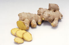 Ginger root sliced. Isolated on white stock photography