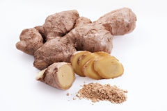 Ginger root with sliced pieces. And powder on the white background Royalty Free Stock Photo