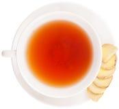 Ginger Root Slices och en kopp te III Arkivfoto