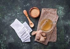 Ginger root and tea bags. Ingredients for cooking healthy drink stock photography
