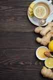 Ginger root tea with lemon and honey on wooden background. Top view, copy space royalty free stock photo