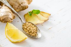 Ginger root on white wood background. Closeup Stock Images