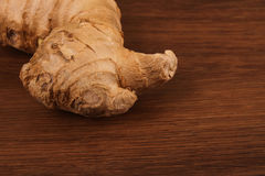 The Ginger root on the wood Stock Images