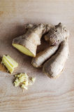 Ginger Root on Wooden Board Royalty Free Stock Photography