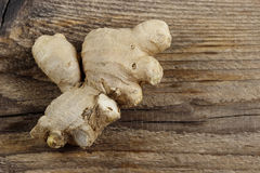 Ginger root on wooden table Royalty Free Stock Image