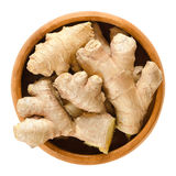 Ginger roots, fresh rhizomes in wooden bowl Royalty Free Stock Photos