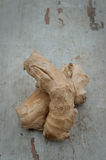 Ginger roots on a wooden board Stock Photo