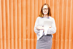 Ginger Schoolgirl by Orange Wall stock image