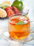 Ginger and strawberry tea. With mint stock image