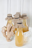 Ginger syrup. Bottles with homemade ginger syrup. Shallow dof royalty free stock image