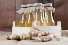 Ginger syrup. Bottles with homemade ginger syrup. Shallow dof Stock Photo