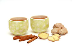 Ginger tea with cinnamon. Two cups of green tea with ginger and cinnamon Royalty Free Stock Photography