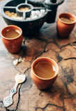 Ginger tea in clay cups  and rustic sugar-bowl on the wooden tab Royalty Free Stock Photography