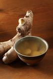 Ginger tea. Cup of ginger tea and fresh ginger stock photos