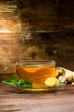 Ginger tea. Freshly brewed ginger tea with mint royalty free stock photos