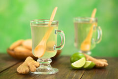 Ginger Tea. Freshly prepared hot ginger tea made of fresh ginger root served in glass (Selective Focus, Focus on the front of the rim and the handle of the glass Royalty Free Stock Images