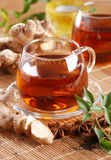 Ginger tea in glass cup Stock Images