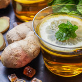 Ginger tea in a glass for flu cold winter days Stock Photos