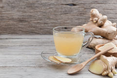 Ginger tea from ground ginger and honey. On rustic wooden background stock photo