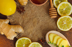 Ginger tea ingredients. Honey, lemon and ginger. Wooden background with sackcloth. Close-up. Top view. Selective focus Stock Photography