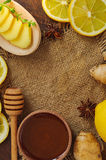 Ginger tea ingredients. Honey, lemon and ginger. Wooden background with sackcloth. Close-up. Top view. Selective focus Stock Images