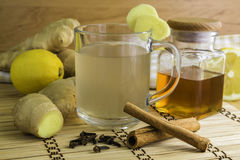 Ginger tea and ingredients like ginger itself, lemon, honey, cin Royalty Free Stock Images