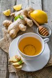 Ginger tea and ingredients on rustic wood background. Copy space Royalty Free Stock Photography