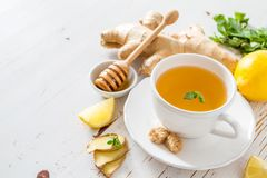 Ginger tea and ingredients on white wood background. Copy space Royalty Free Stock Photos