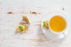 Ginger tea and ingredients on white wood background. Copy space Stock Photo