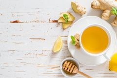 Ginger tea and ingredients on white wood background. Copy space Stock Photos