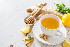 Ginger tea and ingredients on white wood background. Copy space Royalty Free Stock Photo