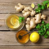 Ginger tea with ingredients on wood royalty free stock photo