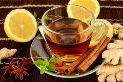 Ginger tea-ingwertee on brown mat with lemon Stock Photography