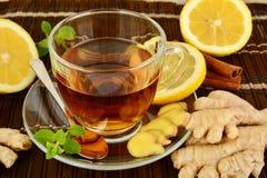 Ginger tea-ingwertee on brown mat with lemon Royalty Free Stock Image