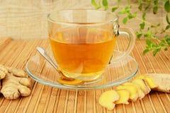 Ginger tea-ingwertee on wooden mat Royalty Free Stock Photos