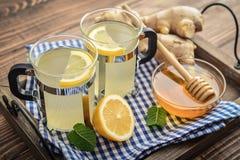 Ginger tea with lemon. And honey on blue background Stock Image