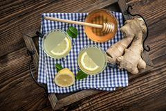 Ginger tea with lemon. And honey on blue background Stock Photo