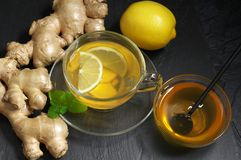 Ginger tea with lemon in glass cup royalty free stock photography