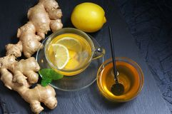 Ginger tea with lemon in glass cup stock photography