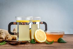 Ginger tea with lemon. And honey on blue background Stock Photos