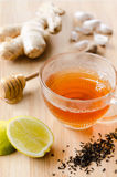 Ginger tea with lemon and honey. Cup of tea with ginger, lemon, honey, garlic for soothing detox drink Royalty Free Stock Image