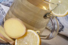Ginger tea with lemon macro on the table Stock Photography