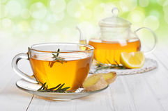 Ginger tea. With lemon and rosematy in glass cup closeup royalty free stock photo